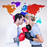 Composite image of business people wearing and boxing red gloves
