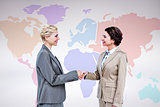Composite image of  smiling women shaking hands