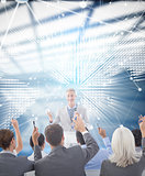 Composite image of business people raising their arms during meeting