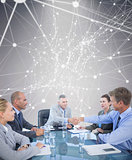 Composite image of business team during meeting