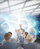 Composite image of business team raising hands during conference