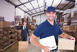Composite image of happy delivery man with cardboard box and clipboard