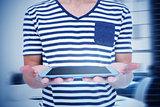 Composite image of close up of man holding tablet