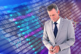 Composite image of businessman sending text