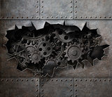 Torn hole in old metal with rusty gears and cogs