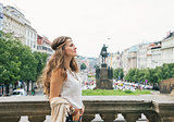 Hippy-looking woman tourist enjoying sightseeing in Prague
