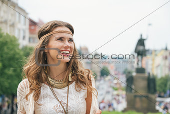 Portrait of longhaired hippy-looking woman tourist  in Prague