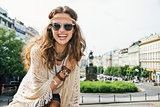 Portrait of smiling young woman wearing boho clothes in Prague
