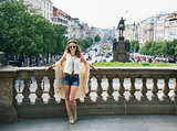 Hippy-looking woman tourist standing on Wenceslas Square, Prague