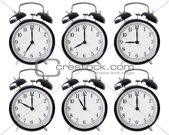 alarm clock set with hands from 7 to 12 o'clock