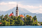 Island with Catholic Church on Bled Lake in Slovenia with Mounta