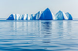 Powerful Bergs Floast silentily in the Arctic Ocean