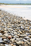pebbled beach beside the links golf course