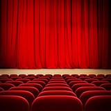 theatre red curtain on stage with red velvet seats