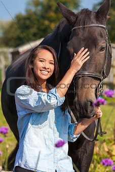 Beautiful Asian Eurasian Girl Leading Her Horse
