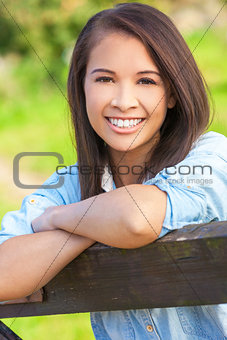 Beautiful Asian Eurasian Girl Resting on Fence