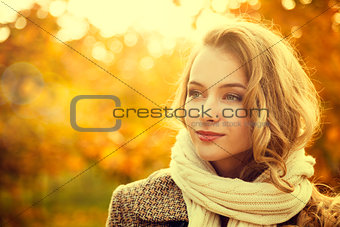 Portrait of Young Fashion Woman on Autumn Background