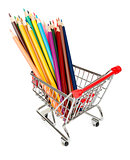 Crayons in shopping cart on white