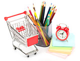 Crayons with clock and shopping cart on white