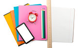 Crayons on copybooks with smartphone