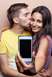 Young couple taking a selfie with mobile phone