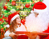 Reading magic book with Santa Claus