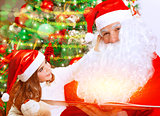 Cute little girl with Santa Claus