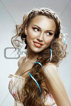 Beautiful  woman. Healthy Long Curly Hair