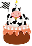 Funny cow on birthday cake