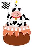 Funny cow on birthday cake