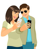 Young couple with cellphones