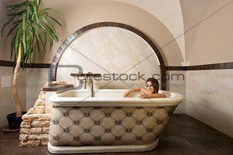 smiling beauty girl in a bathtub