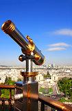 Telescope overlooking Paris up on Eiffel tower, France