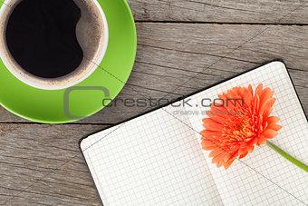Blank notepad, coffee cup and orange gerbera flower