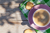 Coffee cup and cookies on garden table