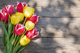 Colorful tulips on garden table