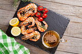 Grilled shrimps and beer mug