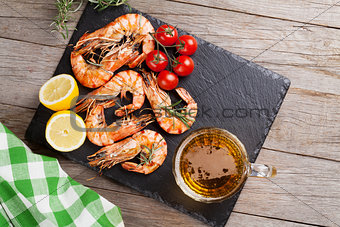 Grilled shrimps and beer mug