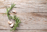 Rosemary and garlic on wooden table