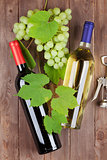 Bunch of grapes, wine bottles and corkscrew