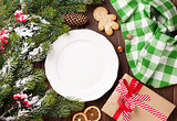 Christmas tree branch, empty plate and coffee