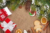 Christmas food, decor and gift box with snow fir tree background