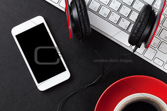 Office leather desk with pc, smartphone and coffee cup