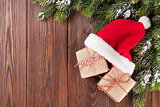 Christmas tree branch and santa hat with gifts