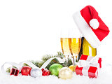 Champagne, christmas decor and santa hat