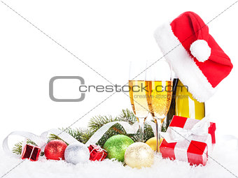 Champagne, christmas decor and santa hat