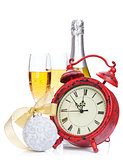 Champagne, christmas decor and alarm clock