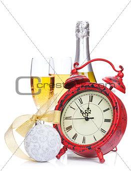 Champagne, christmas decor and alarm clock