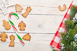 Christmas background with candy cane, gingerbread cookies and sn