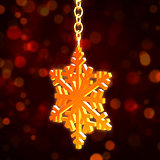 golden Christmas snowflake over red background